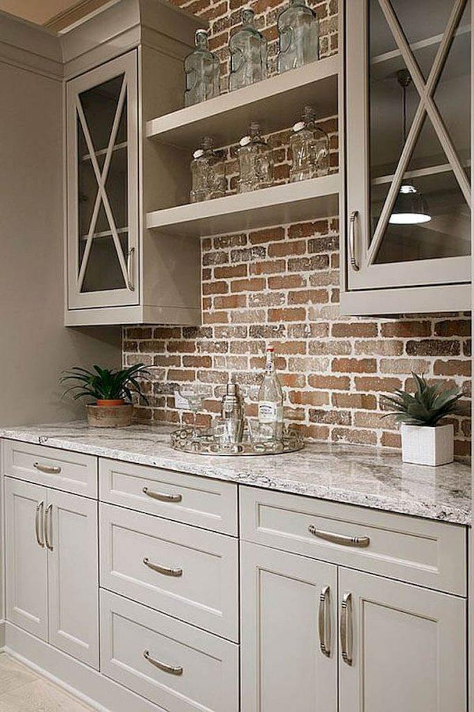 Brick backsplash gray cabinets